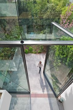 Minimalist House // oversized glass pivoting doors add a nice mix between the existing historical elements and contemporary rear facade