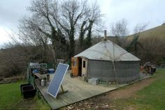 Off-Grid Yurt,  with solar and hydro power, a wood stove and felt insulation.