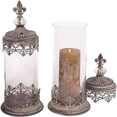 Fleur de Lis medallions and oversized jewels add regal appeal to the Melrose International Candle Holder with Lid - Set of 2 . This candle holder set. Grey Candle Holders, Candle Holder Decor, Grey Candles, Pillar Candles, Jar Candle, Melrose International, Lantern Set, Tuscan Decorating, Hanging Pendants