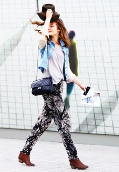 Printed pants, brown ankle boots, and a denim vest