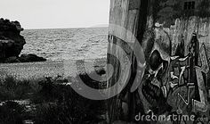 Shot in black and white, detail on an painting on the wall close to the sea, set in Vinaròs, Castellón, Valencia, España, Spain, Europa, Europe