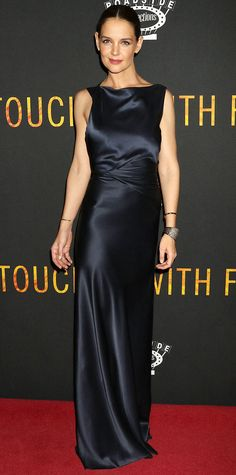 Katie Holmes wowed at the Touched With Fire premiere in a dark slinky Zac Posen number with ruching at the bodice and a sexy asymmetric back.