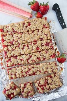 Strawberry Rhubarb Oatmeal Bars via Sift & Whisk (halve the sugar)