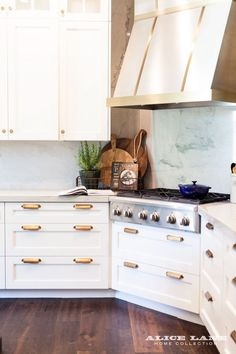 Replace marble with Quartz slab as a backsplash for a low maintenance but super sophisticated option. The All-American Kitchen & Dining | Alice Lane
