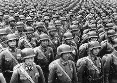Chinese cadets in full battle dress, with German type of steel helmet, parade somewhere in China on July 11, 1940.