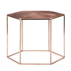 Elegant copper-plated Hexagonal Coffee Table from Out There Interiors.