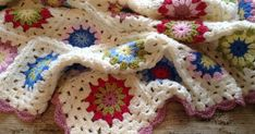 Crochet tutorial - The Granny Flower Motif.  Learn how to make a simple flower granny square in this easy tutorial...