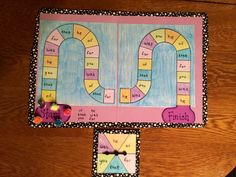 My Sight Word Board Game! Colored the game board, laminated it on a file folder, wrote the words in wet erase marker, and accented with Duck Tape! Cheap and easy!