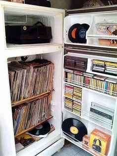 vinyls, tapes, cassettes, & accessories in an old refrigerator Vinyl Music, Vinyl Records, Appartement Design, Vinyl Record Storage, Vinyl Junkies, Record Players, Piece A Vivre, Music Images, Repurposed