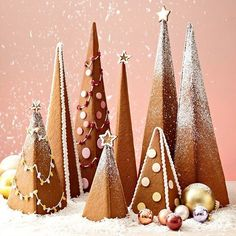 Gingerbread Trees - Every homemade gingerbread house deserves a dazzling display of Christmas trees. Decorate these easy-to-assemble gingerbread cookie trees to your heart's desire with our quick icing recipe, powdered sugar, and pastel candies. Christmas Gingerbread House, Christmas Sweets, Christmas Cooking, Noel Christmas, Christmas Goodies, Gingerbread Cookies, Christmas Crafts, Christmas Decorations, Gingerbread Houses