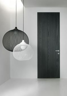 Moooi non-random lights. Segno Flush frameless door. The frame is integrated in the drywall. Nice.