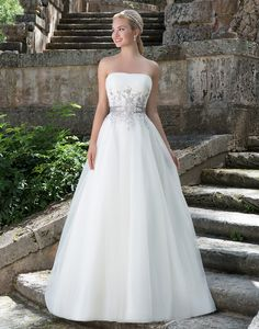 Sincerity wedding dress style 3883 Strapless softly ruched tulle bodice with full ball gown skirt fit for the modern princess. This traditional gown features embroidered lace on the bodice, a detachable beaded grosgrain belt and chapel length train.