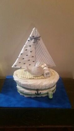 Sailboat diaper cake. Ideal for a nautical or sailboat themed baby shower! Baby shower ideas and inspiration
