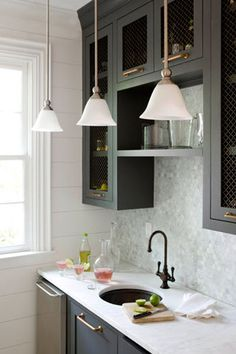 When a sink faces the wall (because it has to), make your view in the sink interesting.....shelves, ...and also raise the head height