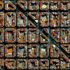 10/2/2014 L'Eixample Valencia, Spain 39°27′53″N0°22′12″W  The urban plan of the L'Eixample district in Valencia, Spain is characterized by long straight streets, a strict grid pattern crossed by wide avenues, and square blocks with chamfered corners.