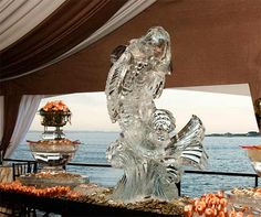 A raw bar featured oysters, mussels, shrimp cocktail and a shimmering ice sculpture.
