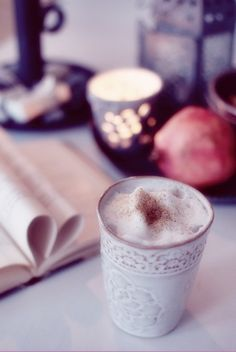 coffee with whipped milk and a little cinnamon on the top, served in a nice cup by someone I love