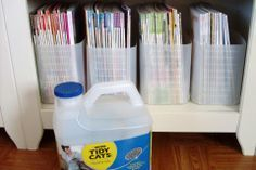 Turn cat litter containers into tidy magazine holders. Cut off the ...
