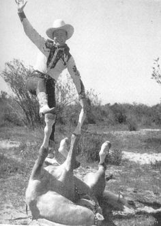 """Roy Rogers balancing on one of the several Palominos he called """"Trigger."""" The one known as """"Trigger Jr."""" (no relation to the original Trigger) was the Palomino he used most for personal appearances and tricks."""