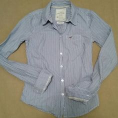 Hollister stretch long sleeved top 98% cotton 2% elastane.  Versatile...looks cute buttoned up for a preppy look or wear it unbuttoned with sleeves rolled up over a tee for a more relaxed look. Hollister Tops Button Down Shirts