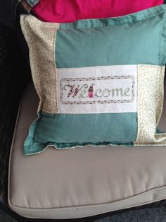 Welcome stitched on band.