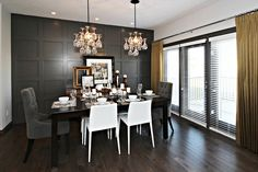 Sabal Homes: Amazing gray and yellow dining room with dark gray full wall wainscoting and silk ...