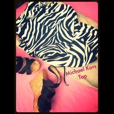 Michael Kors shirred zebra top. This is not a tee shirt. It's a heavier material. Excellent conditions. Worn once. Michael Kors Tops