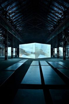 warehouse projections _ the whole space is transformed to allow the audience to step into another dimension .