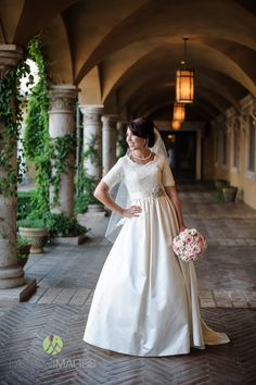 Modest wedding dress by Alta Moda Bridal on real bride Victoria. Image by Lasting Images Photography