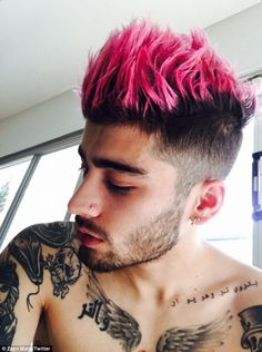 Zayn Malik unveiled a new pink dip-dyed barnet in a shirtless selfie posted on Twitter on Saturday