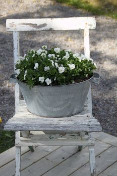 ...Sweet tub with floors..love the old chair. www.dirtygirlfarm.com