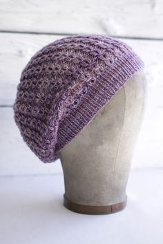 """Another fabulous design from our friends at Fairmount Fibers! Designed by Lisa Myers, Martine is a free hat knitting pattern. It has a repetitive St John's Wort stitch pattern and just the right amount of slouch. Completed hat measures: Women's Medium (band circumference about 20"""")"""