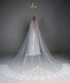 This simple but elegant cathedral veil is handmade with Chantilly lace embellishment.