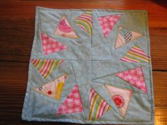 Blue flying geese table center pice or candle mat by RachaelsCrazyScraps on Etsy https://www.etsy.com/listing/220222232/blue-flying-geese-table-center-pice-or