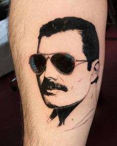 8a1147c8e3237 Get to witness the most amazing Freddie Mercury tattoos and deisgns here.  We have the most splendid art styles that will tell you all the meaning of  Freddie ...