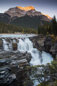 Waterfall Sunset - Athabasca Falls, Jasper National Park, AB I was pretty stoked to photograph three of my favourite subjects (waterfalls, mountains & sunset or rise) all in one shot.  Sunset at the always popular Athabasca Falls and Mount Kerkeslin on a fall evening, surprisingly there were only a few people around on this day. #LandscapeSunset