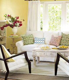 aquamarine positively pop. A slip-covered sofa, a weathered coffee table from H.   Read more: Living Room Decorating Ideas - Tips for Bright Colored Living Rooms - Country Living