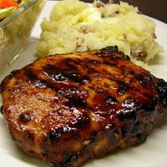 Grilled Mongolian Pork Chops Recipe - Once marinated, these pork chops can be cooked any way you like, but for the true experience, youre going to want to cook these on a charcoal grill. For me, its the smokiness that brings all these flavors together. Pork Chop Recipes, Meat Recipes, Cooking Recipes, Recipies, Mongolian Pork Chops Recipe, Mongolian Beef, Sauce Hoisin, Soy Sauce, Grilled Pork Chops