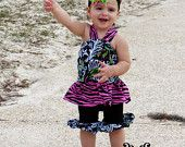 Zebra top and capris on my beautiful godchild.. Oh sew charming on etsy.com