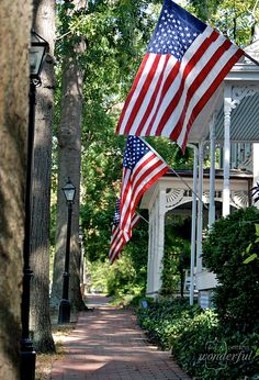 Red White & Blue flags displayed on beautiful victorian houses. What a lovely scene of patriotic pride. Great idea for of July celebration and exterior decorations. I Love America, God Bless America, America America, American History, American Flag, American Pride, American Independence, American Country, American Apparel