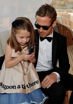 Ryan Gosling with a little girl