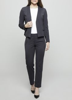 Collarless suit jacket and trousers in steel grey. Jacket has a magnetic closure and flap pockets. Pants have front pockets and a smooth back. Made by Rose&Willard. Available at www.HouseofParrish.com