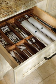 Organize in style with this sleek walnut drawer divider
