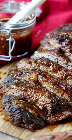 Oven-Barbecued Beef Brisket recipe from Cook's Illustrated. Wrapped in bacon for smokiness. The best brisket cooked in the oven you will ever taste! Brisket is the butter of meats. Beef Brisket Oven, Oven Roasted Brisket, Pork Ribs, Bbq Beef, Cooking Brisket In Oven, Brisket In The Oven, Grill Barbecue, Smoked Brisket Recipes, Baked Brisket