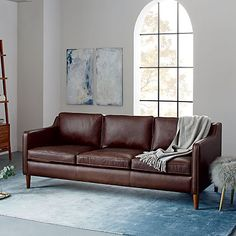 This mocha Hamilton Leather Sofa from West Elm adds a rich, natural feel to the space. The darker, waxy texture would look great with Cocoa Bronze accents from Liberty Hardware.