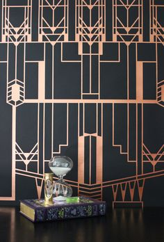 "NEW!: Our Chicago : Mexico City wallpaper is now available in ""Dorado'. Metallic bronze on matte black. It's even better in person!"