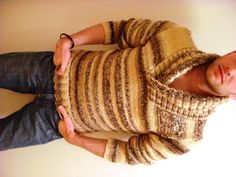 I love this sweater. I might buy the pattern and make it for my cousin. Sidebar - I love it when men knit. :-)
