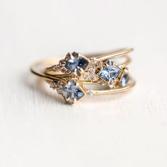 In the Sky ring with periwinkle blue sapphire and a side sweep of white diamonds  Limited edition and available at melaniecasey.com