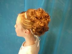The holiday season means parties and special events galore! Have your flower girl looking festive and special with this elegant updo from Youtube channel Hair4myprincess.  It is SO much easier to create than it actually looks, and she'll be the star of the party! Learn how to do this hairstyle on our blog here: http://www.flowergirlworld.com/2012/12/fun-to-wear-wedding-hair-elegant-holiday-updo/