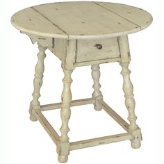Accent a room with a look of yesteryear with this antiqued round accent table. This hand-painted hardwood table features an antique finish and hardware, giving this piece a distressed appearance, and a single drawer provides additional storage.
